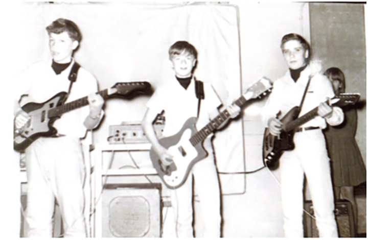 Taylor Mathews' grandpa, Howard Taylor (far right), plays the electric guitar with his band in 1966. Taylor was in eighth grade at the time, and his band eventually named themselves The Shades of Dawn.