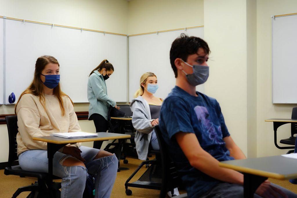 Sophomore Johnathan Flint (right) sits in Professor Matt Micek's Biostatistics class in the Rockwell Academic Center on June 7. The class was Flint's first-ever in-person college class, a year after he enrolled at Pepperdine.