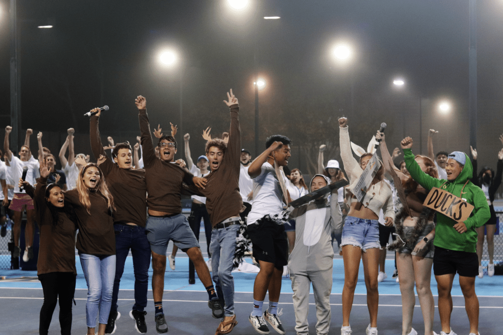 First-years, dressed as Pepperdine deer and other wildlife, jump in glee after agreeing to get along while occupying the Malibu campus at the Ralphs-Straus Tennis Stadium during Frosh Follies on Aug. 28.