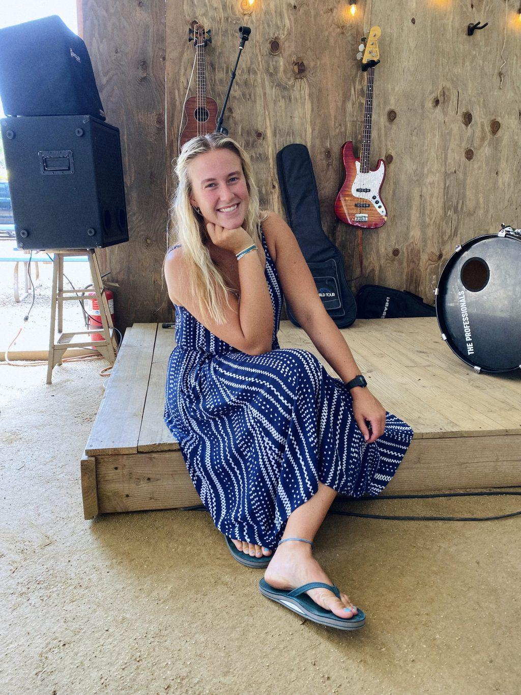 Worship leader and senior Lily Dyer smiles after she hops off stage from a wonderful time of worship and song. Dyer played guitar and led with vocals.