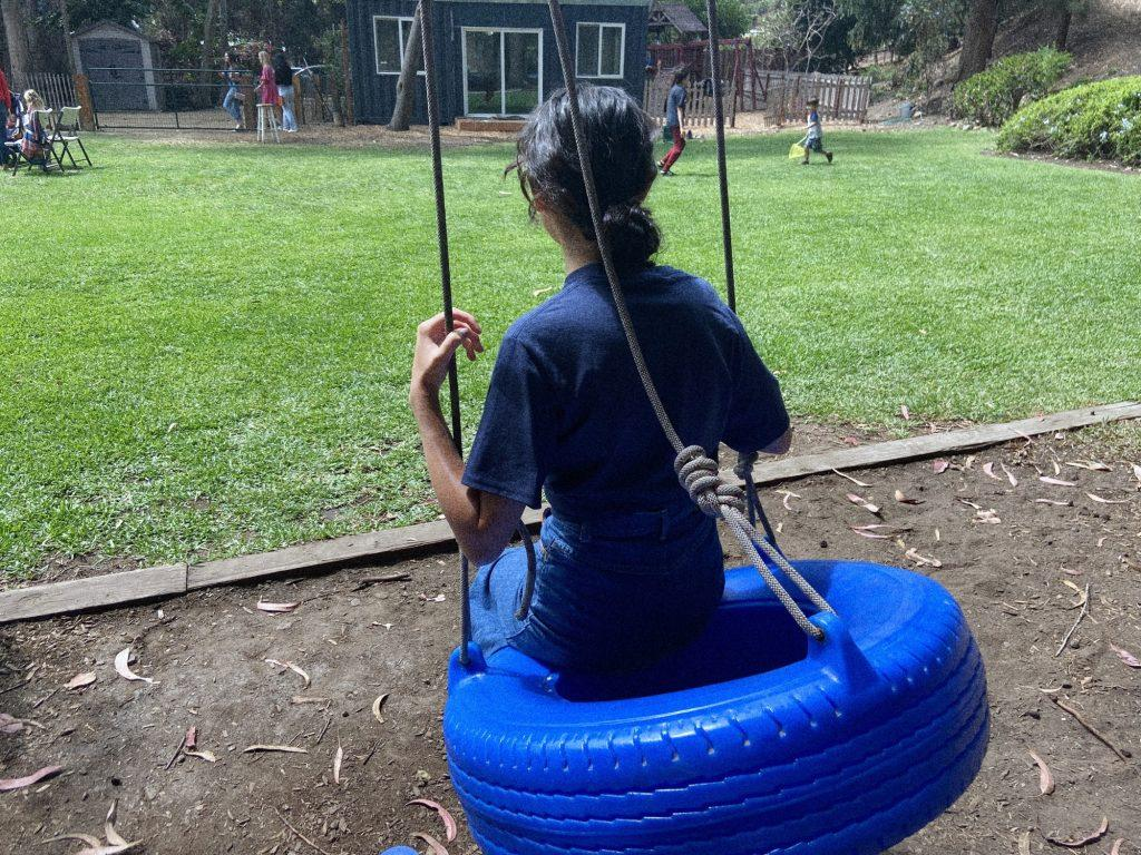 Life & Arts Editor Beth Gonzales (and the author of this piece) spends time on the famous rope swing while children play around in the scenery of vineyards and hills. The Gathering had many Pepperdine students serve in their children's ministry in the 2020-2021 academic year and over the summer.