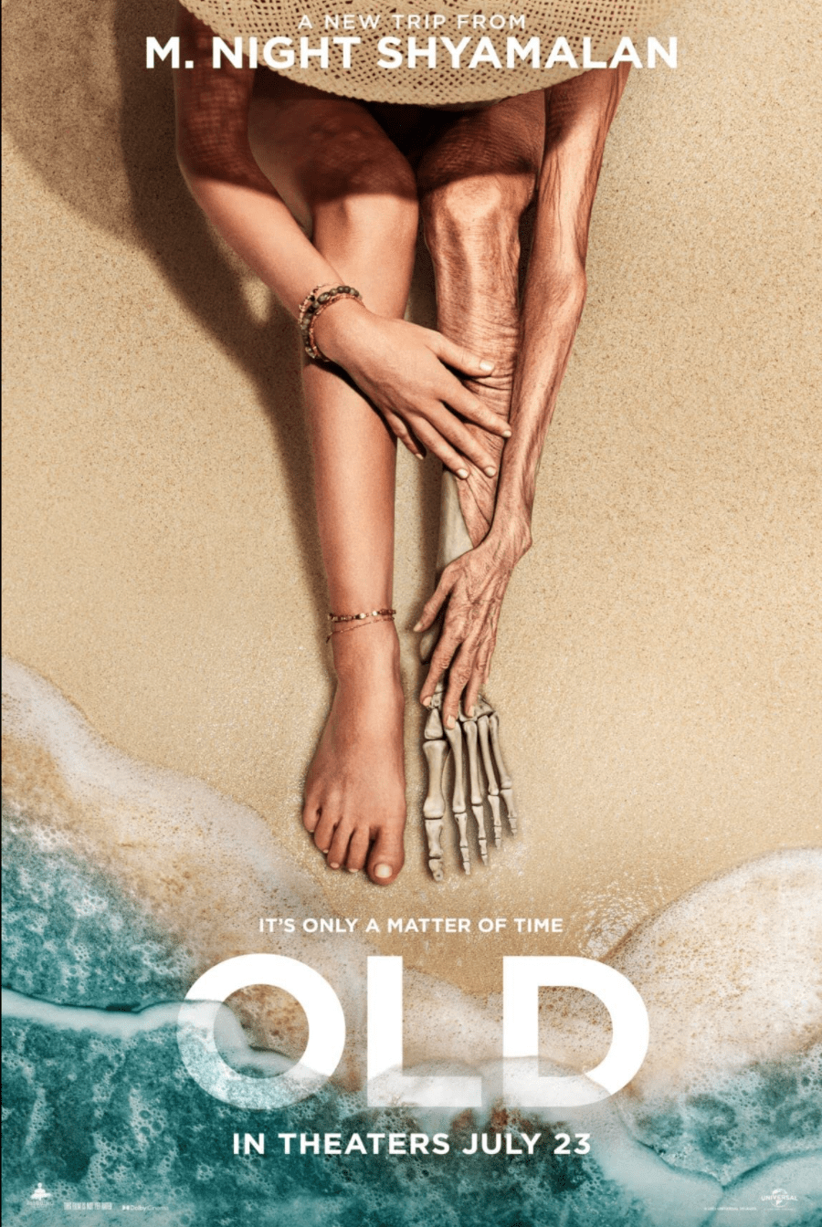 """The poster for """"Old"""" shows a woman sitting on a beach as her leg becomes just bone, a sign of her rapid aging. This kind of supernatural plot is typical for director Shyamalan, who rose to prominence with his 1999 hit, """"The Sixth Sense,"""" and is known for his film&squot;s plot twists and suspenseful tones. Photo Courtesy of Universal Studios"""