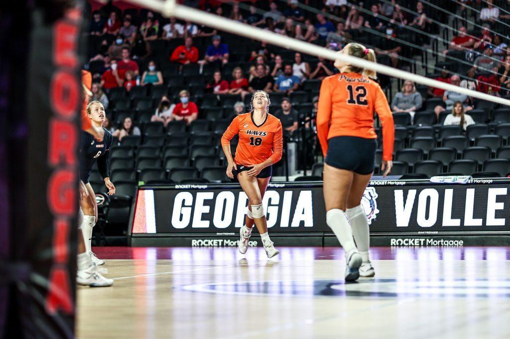 Rachel Ahrens (No. 18) and Meg Brown (No. 12) track a ball up high during the match against Georgia at Stegeman Coliseum in Athens, Ga., on Saturday, Aug. 28, 2021. The duo combined for 30 of the team's 61 kills in the match.