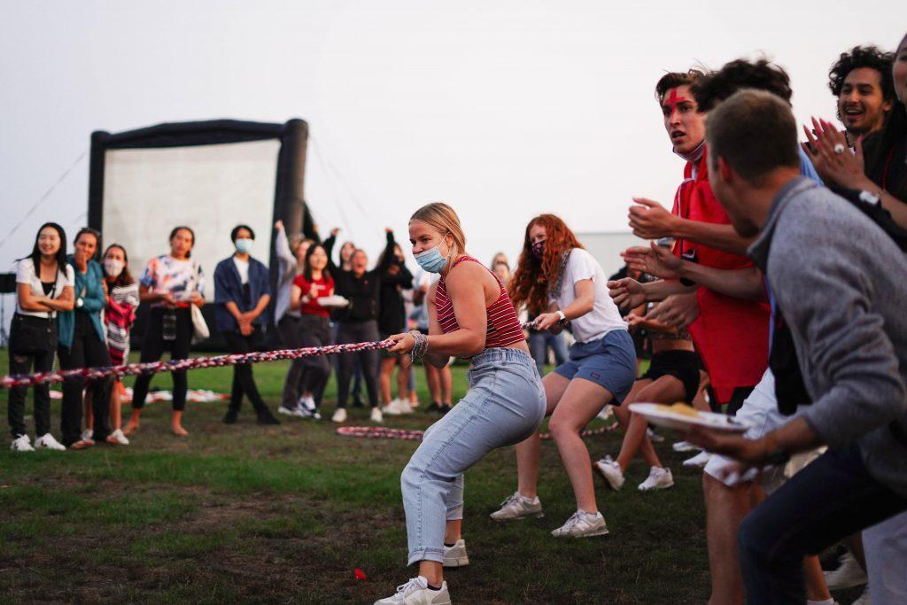 Lausanne program alumni compete in the tug-o-war at the Return as students cheer on. The competition and the Return itself brought together many members of the Class of 2022, who studied abroad their sophomore year and whose programs were cut short due to the COVID-19 pandemic.