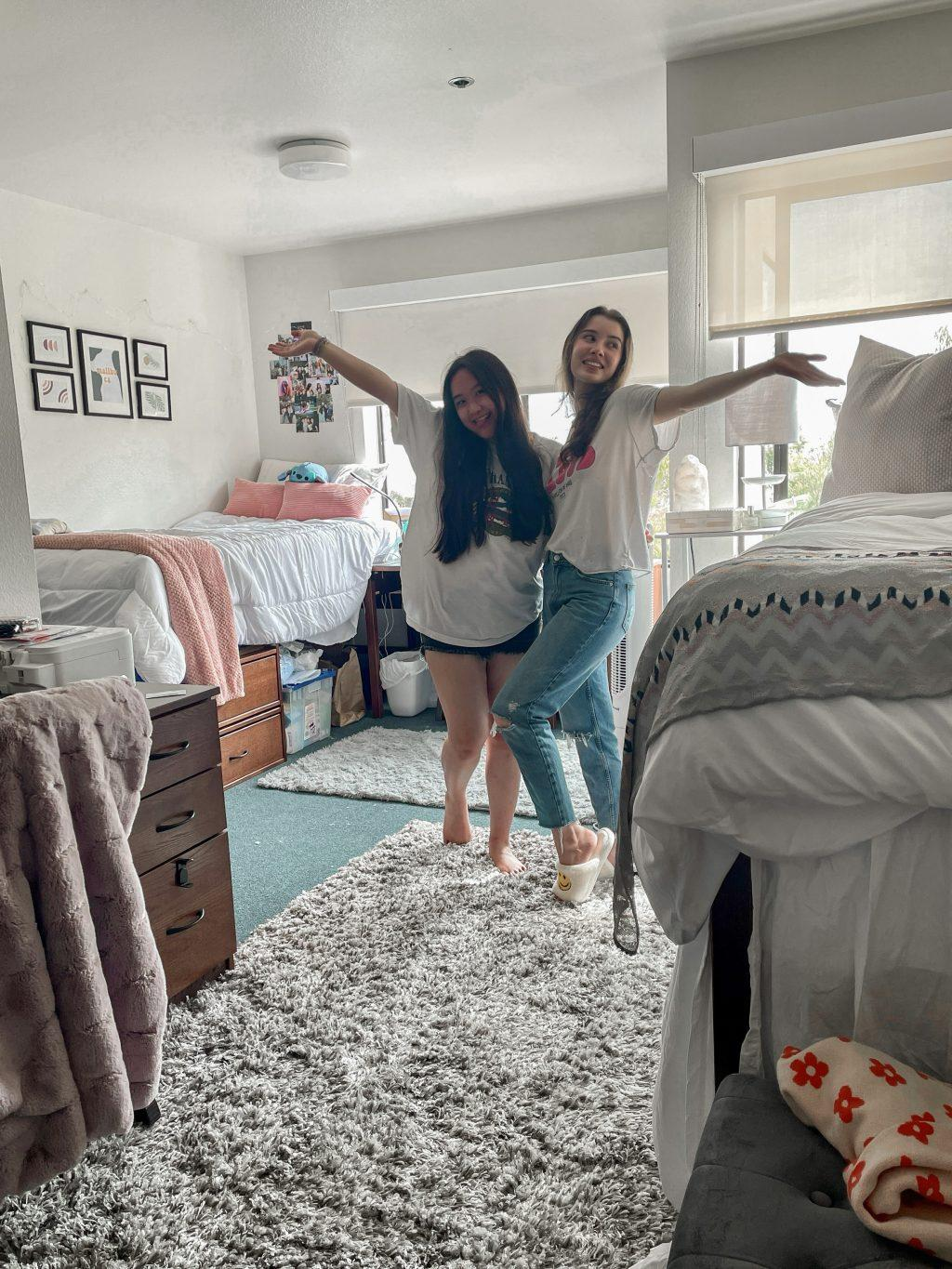 Sophomore Nathania Au and her roommate Liza Esquibias pose in their decorated room Aug. 24. Au said she and her roommate found inspiration for their room on Pinterest, TikTok and Instagram. Photo Courtesy of Nathania Au