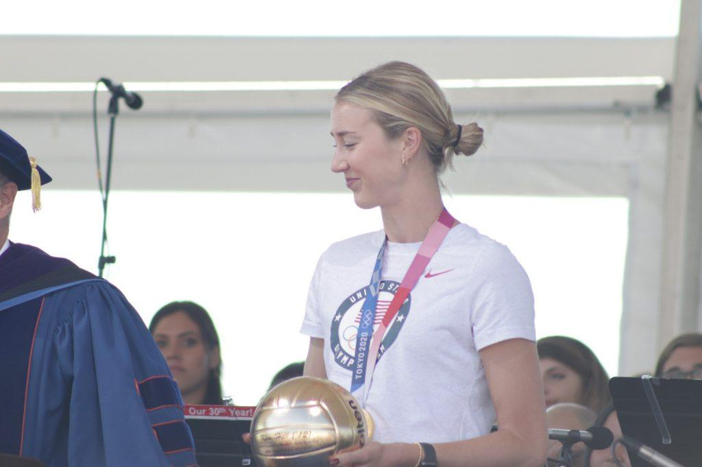 Hill receives a golden volleyball from President Jim Gash to celebrate her achievements after graduating from Pepperdine in 2012. Hill attended Founder's Day to celebrate the University and return to her alma mater after her victory in the 2020 Tokyo Olympics. Photo by Denver Patterson