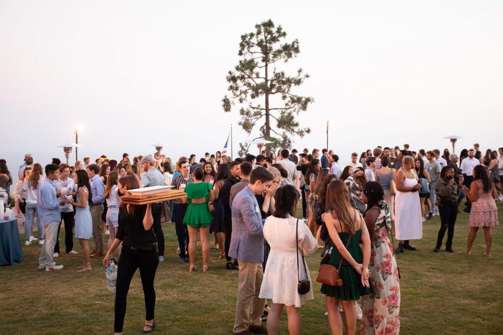 The senior class enjoys conversation and food at the Brock House the first week of their last year at Pepperdine. Due to renovation at the house in 2019, the annual tradition of Rock the Brock has not been hosted at the Brock House in three years.