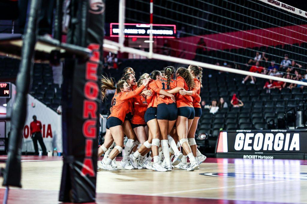 The Waves celebrate after winning the fifth set 15-11. The win secured the match and a perfect 3-0 record in the opening weekend.