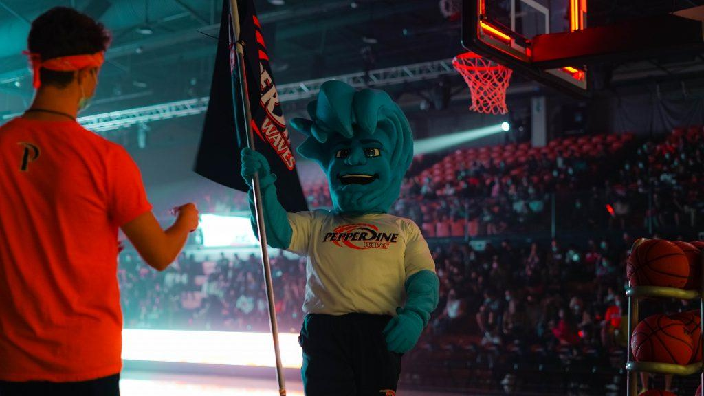 Willie the Wave flies his Pepperdine flag at Blue and Orange Madness. The event took place in Firestone Fieldhouse and was a pep rally to kick off the men's and women's basketball seasons. Photo by Dane Bruhahn