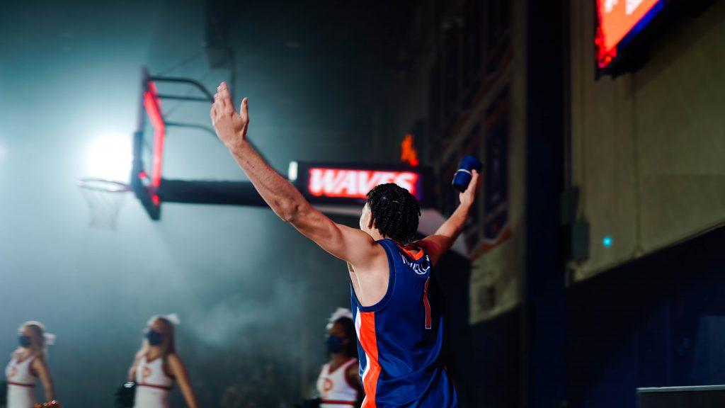 Men's basketball player Mike Mitchell Jr., raises his hands to cheer on his teammates at Blue and Orange Madness. Each year, the University holds the pep rally to get students, parents and alumni excited about the upcoming basketball season. Photo by Dane Bruhahn