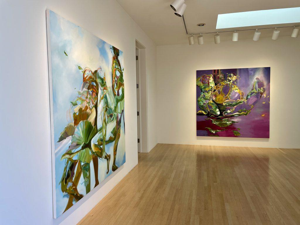 """Whimsical forms move in nature in a photo of Gellis&squot; """"Ascension"""" (left) and """"River Gods"""" (right). These two pieces — lit by natural skylight — are the first paintings spectators see when they enter the exhibition."""