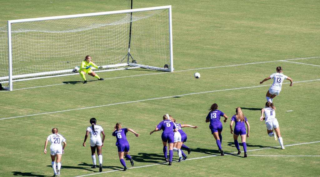 Trinity Watson (No. 13) takes a penalty kick against University of Portland on Saturday, Oct. 2. The Waves won by a score of 3-0, and improved to 10-1-0 on the season.